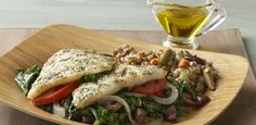 Fish is always a reliable ticket to a fast dinner. Here, simple cod fillets are paired with healthful kale, olives and tomatoes in an easy skillet dish.
