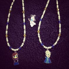 Frozen inspired Anna, Elsa and Olaf necklaces.  Stainless steel, hypo-allergenic and glass components, except the coloured crystals which are Swarovski.  Can also make in sterling silver and Swarovski exclusively.