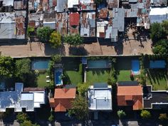 A birds' eye view of the Buenos Aires slum La Caval, top, and a gated suburban community, below. La Cava's jumble of ramshackle plywood homes has grown swiftly in a country where the contrast between rich and poor is particularly obvious. Photograph: Natacha Pisarenko/AP