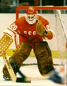 This photo features USSR legend Vladislav Tretiak crouched in goal wearing red. The photo is hand autographed, comes as shown, with Hologram and Certificate of Authenticity. Army Hockey, Stars Hockey, Hockey Goalie, Hockey Games, Hockey Players, Ice Hockey, Goalie Gear, Olympic Hockey, Hockey Pictures