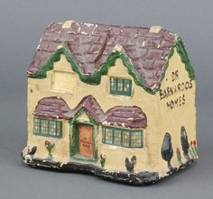 "Lot 357, A fibre Dr Barnardo's collecting box in the form of a house 4"" x 3 1/2"" x 5"" est £30-50"