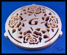 Rose Trivet wit Initials. 26 patterns plus a blank from Scrollsaw Workshop #SteveGood #fretwork #trivets #rosepattern #monograms #freewoodworkingplans #scrollsawplansandprojects