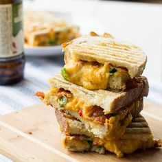 Pimiento Cheese Panini with bacon      1 1/3 to 1 1/2 cup Pimiento Cheese     4 to 6 slices of bacon, cooked and crumbled     2 green onions, sliced, green parts only     8 slices ciabatta or Italian bread     butter of cooking spray