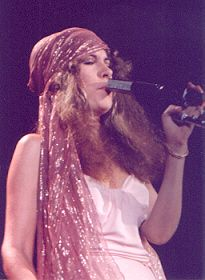 Stevie, looking lovely in pastels  ~ ☆♥❤♥☆ ~    wearing a glittery shawl as a headscarf onstage, 1979