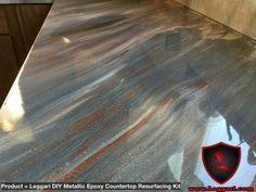 This countertop was coated with a Leggari Products DIY Metallic Epoxy Countertop resurfacing Kit. The kits start at $332 and includes shipping within the states. The kit comes with our specifically formulated pigmented primer that will chemically bond to a number of different surfaces. Our super clear high gloss and scratch resistant 100% solids epoxy. Two metallic colors of your choice with 17 vibrant metallic colors to choose from. The kit will cover 50 sq ft so order your kit today…