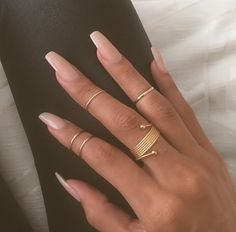 gold rings + neutral nails