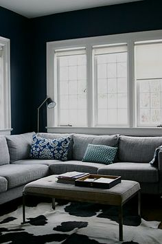 Love The Navy Blue Walls White Trim And Grey Sofa Cowhide Rug Can Go