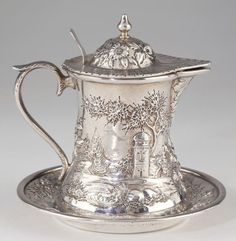 "S. Kirk & Son Co. sterling silver  ""Landscape"" pattern covered syrup pitcher and tray, c1900 (Leland Little Auctions)"