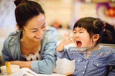 Stock Photo : Little girl talking joyfully with mom