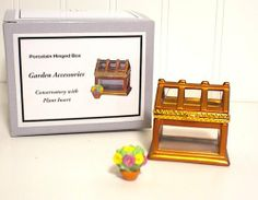 """Midwest of Cannon Falls Conservatory PHB Trinket Box . $5.99. Measures 2"""" high.. Conservatory PHB porcelain hinged box with mini Plant trinket inside. Hinged box is from Midwest of Cannon Falls"""