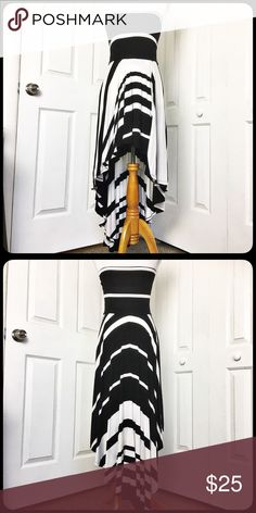 """Ocean Drive High Low Dress Beautiful black and white dress by Ocean Drive Clothing Co.  Very soft being made of  5% spandex and 95% rayon.  Dress is in excellent condition.  Measurement laid flat and unstretched: bust 13"""", waist 14"""", hip 20"""" and length to shortest part of hem 27"""" and longest 48"""". Dresses High Low"""