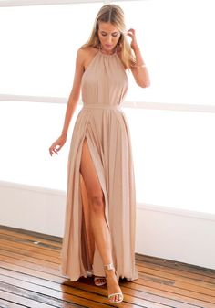 Dress // Rock this nude M-slit halter dress with ankle strap heels for a striking appearance to any formal event.