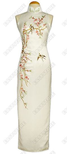 All will defer to your beauty and essence in this Stunning Tao Hua Embroidered Silk Cheongsam....