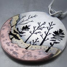 Love this necklace with the trees, different textures and metals!    Great design for any nature or outdoors lover!  LOVE THIS