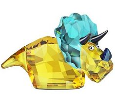 Swarovski Dinosaur Travis Triceratops. Swarovski Dinosaur Travis Triceratops  Swarovski Triceratops Dinosaur - Travis  This colorful Swarovski Dinosaur features a vivid golden tone body,antique Gree Aurore Boreale crystal crest and horns done in a Jet Metallic Blue. Slow and easy is his motto. Not intended for children 15 and under.