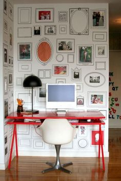 a white wall of hand-drawn picture frames for snapshots and ephemera in hakarl and jili's condo in brooklyn