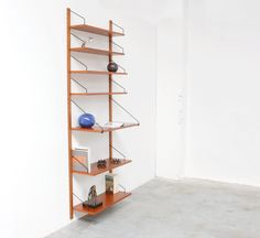 this single hanging wall unit is designed by poul cadovius for royal system denmark in the