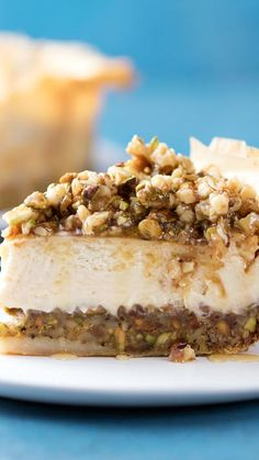 Made with a phyllo dough and pistachio crust, this creamy, honeyed baklava cheesecake incorporates the best of both desserts. Made with a phyllo dough and pistachio crust, this creamy, honeyed baklava cheesecake incorporates the best of both desserts. Just Desserts, Delicious Desserts, Yummy Food, Summer Desserts, Greek Dessert Recipes, Honey Dessert, Layered Desserts, Dessert Food, Healthy Desserts