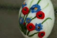 Needle felting white easter egg with poppies wool by ElisFeltCraft