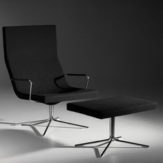 One of our newest added products! Do you like this Bond High Back Easy Chair and Footstool by Offecct?