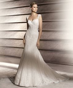 Lace & simple.  Patty, elegant fit and flare lace wedding dress with straps.