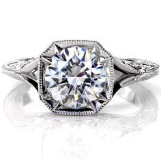 A 2.00 carat round brilliant diamond is proudly displayed in a vintage inspired octagonal bezel with eight delicate pointed prongs.  http://www.knoxjewelers.biz/products/catania