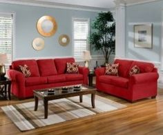 Bring some spice and pizzazz to your living room with this brilliant red living room decor! It includes red living room furniture, wall decor,...