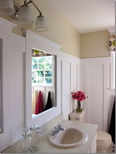DIY Home Improvement: How I Updated a Bathroom on a Budget-How to make a tiny window look bigger with molding