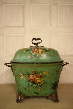 A very decorative, early 19th century antique purdonium, which is a coal scuttle or box. This purdonium is in the original green paint finish