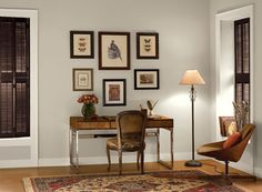 Benjamin Moore Paint Colors - Neutral Home Office Ideas - Poised & Pretty Home Office - Paint Color Schemes . . . . . Warm shades of creamy white and earthy gray soothe this pretty workspace. . . . . . Walls - Wish (AF-680); Trim - Gardenia (AF-10); Accent (shutter blinds) - Wenge (AF-180).