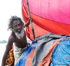 Bangladeshi fisherman on his boat, Barisal, Barisal District, Bangladesh