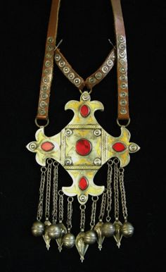 "Large Teke Turkomen pendant necklace | Many pieces of Turkmen ""jewelry"" were sewn to clothing as amulets. This rare Teke Turkomen pendant was originally worn as a necklace and still has the original leather neckstrap. This piece has 5 flat carnelians and gold wash or ""fire gilt"" detail 
