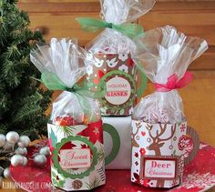 Paper Mug tutorial. Create paper mugs with a score board and Christmas paper to fill up with Christmas treats to give and unique gifts.