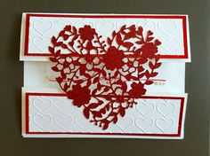 Valentine Card made with Stampin' Up Bloomin' Heart Thinlits Dies, Happy Heart Embossing folder, red glimmer paper for the heart, red foil sheets and Whisper White card stock on the card, Wonderful Words stamp set, Real Red ink, and some mini pearls for embellishment.