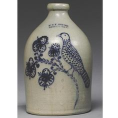A FINE AND RARE 1-GALLON SALT-GLAZED COBALT BLUE SLIP-DECORATED 'BIRD WITH DOTTED BREAST AND FLORAL SPRAY' STONEWARE