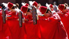 Seoul, Korea: College students wearing traditional costumes dance during a graduation ceremony at Sungkyunkwan University