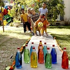 Make your own lawn bowling pins by filling some recycled plastic bottles with water and food coloring.
