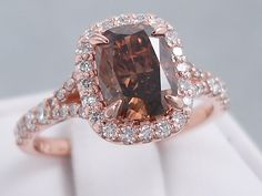 This is our amazing ctw Cushion Cut Chocolate Diamond Engagement Ring. It has an exquisite carat Cushion Cut Center Diamond that is Chocolate Clarity, Clarity Enhanced (Fracture Fi (Chocolate Color Dress) Cushion Cut Engagement Ring, Rose Gold Engagement Ring, Chocolate Rings, Chocolate Color, Chocolate Diamond Wedding Rings, Rose Gold Diamond Ring, Modern Jewelry, Or Rose, Bridal Jewelry