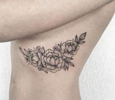 anna bravo floral rib tattoo