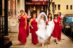 Bridesmaids in red dresses     PHOTOGRAPHER: Holland Photo Arts
