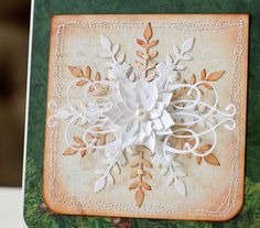 Snowflake repeated in different color, topped with flourish and white flowers in the center