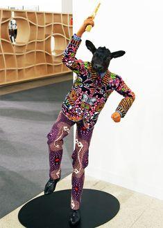 'revolution kid (calf)', yinka shonibare, mbe, 2012  mannequin, dutch wax printed cotton, fibreglass, leather, taxidermy calf head and 24 carat gold gilded gun
