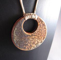 http://potteryblog.com/uploaded_images/soda-glazed_ceramic_pendant-712205.jpg