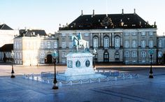 The Main Royal Residence  The Amalienborg complex was originally four, externally identical, noblemen's palaces, symmetrically placed around an octagonal palace yard with the equestrian statue of Frederik V, by the French sculptor J.F.J. Saly, in the centre.
