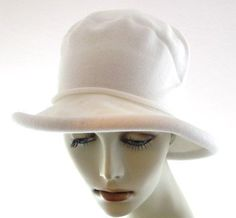 Parkhurst Packable Peggy Cotton Sun Hat (White) by Parkhurst. $33.95. 100% Cotton Sunguard knit hat has a 2.5 inch brim with padded edge for great sun protection.  Packs flat for travel.  Headsize is approximately 23 inches but will stretch to fit a slightly larger head.  Washable. Made in Canada.