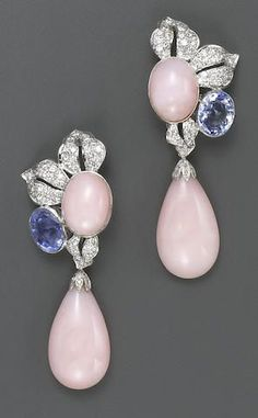 A pair of pink opal, sapphire, diamond and fourteen karat white gold pendant earrings