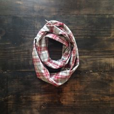 Part of our Southern Songbook Collection, this infinity scarf is crafted from a vintage red + grey plaid. Whether you come from Alabama with a banjo on your knee  (or a scarf around your neck), you'll be a stand out in this deadstock plaid. Limited run of 10 pieces. One size. Handcrafted in Nashville, TN