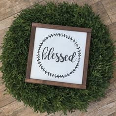 Blessed: 12x12x1.5 Customize with your choice of frame and color. Picture is shown with Ivory Background, Black Lettering a Dark Walnut frame.  This item is handmade right on the farm here in Idaho. Full of that farmhouse chic, Fixer-Upper style that were all craving. Customize your wood sign with your choice of lettering color and frame stain options. Perfect for any room of the house! Here at Huckleberry Avenue our made-to-order signs are made of real wood and hand painted, followed by a…