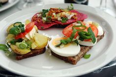 Wonderful to have for lunch! // Smørrebrød is the traditional Danish open-faced sandwich. Usually it is made with dark rye bread, and topped with the most diverse variety of things: meats, fish, eggs, vegetables, you name it.