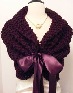 Hand knit purple wedding shawl. Made of soft wool blend yarn: 20% wool, 80% acrylic. Fastens with a satin ribbon and ties into a bow. There are